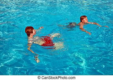 children having fun in the pool