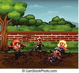 Children having fun playing in the mud