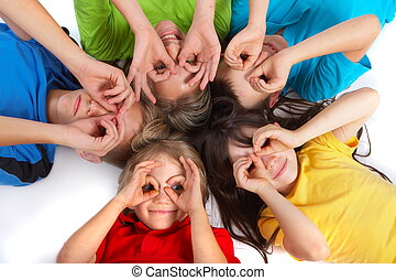 Children Having Fun - Five children laying in a circle with...