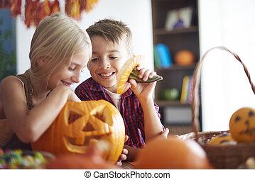 Children having fun with pumpkin