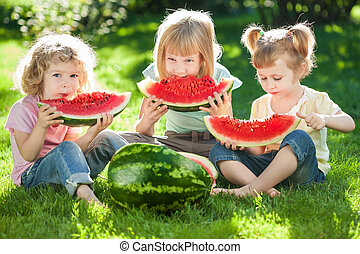 Children having picnic in summer