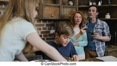 Children Helping Parents With Cooking Cutting Vegetables, Happy Family Preparing Food Together In Kitchen
