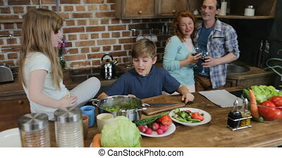Children Helping Parents With Cooking Dinner, Happy Family Preparing Food Together In Kitchen