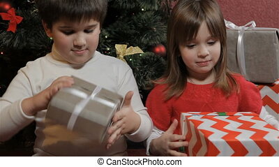 Children hold gift boxes in their hands