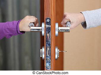 door handle - children hold hands on the door handle