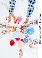 Children holding balloons