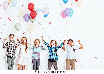 Children holding balloons