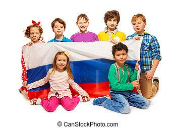Children holding big flag of Russian Federation