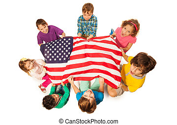 Children in a circle around the flag of America - Top view ...
