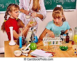 Children in chemistry class.