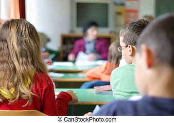 Children in classroom - Kids in classroom studying,...