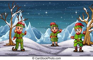 Children in elf costume on winter landscape