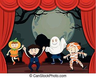Children in halloween costume on stage