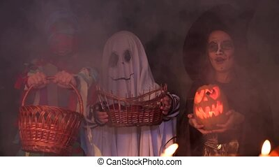 Children In Halloween Costumes Playing Trick Or Treat