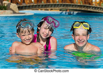 Children in pool on holiday