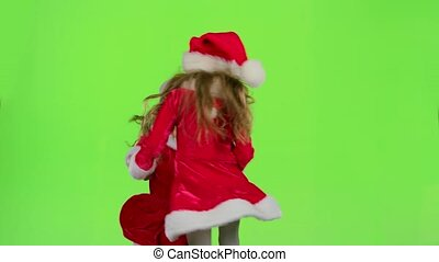 Children in red New Year costumes are dancing. Green screen