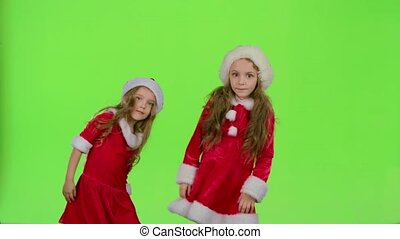 Children in red New Year costumes are dancing. Green screen. Slow motion