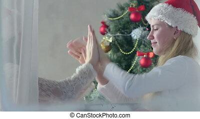 children in santa hat playing