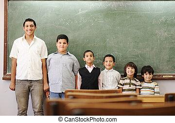 Children in school, from kindergarten, preschool, elementary age, to college boy
