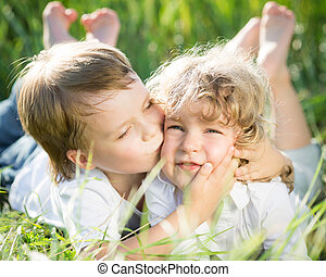 Children in spring - Happy children playing outdoors in...