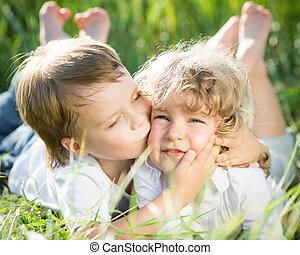 Children in spring - Happy children playing outdoors in ...