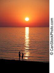 Children in sunset at the sea. Batumi. Georgia