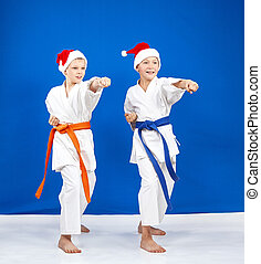 Children in the rack of karate hit punch arm