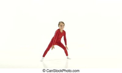 Children is sitting on the twine and showing a thumbs up. White background. Slow motion