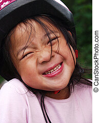 close up of child while laughing