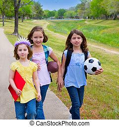 Children kid girls walking to school with sport balls