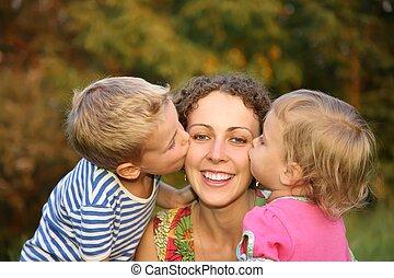 children kiss the mother