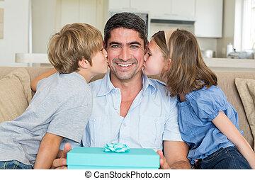 Children kissing on fathers cheeks - Loving children kissing...