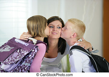 Children kissing their mother