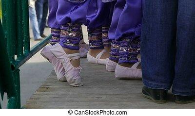 children knead feet to dance a slow motion video - children...