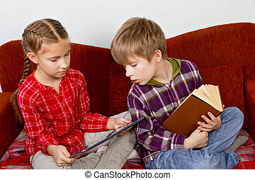 Children learn from the book readers and tablets