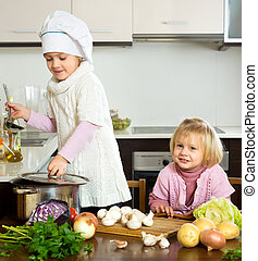 Exciting small girls learning how to cook indoors