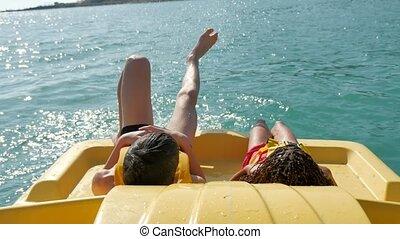 children lie resting on a yacht boat sea ocean. children sea...