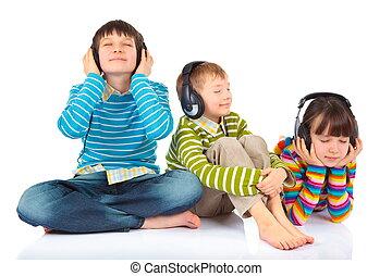 Children listening to music - Cute children listening to ...