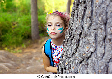 children little girl playing in forest tree makeup