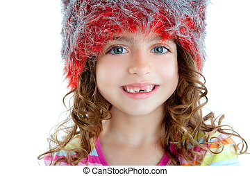 Children little girl with winter fur cap orange and silver