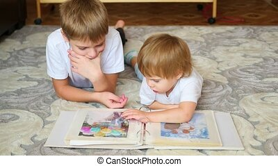children look pictures of a family photo album
