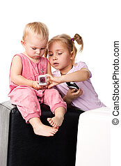 Children looking into the mobile phone isolated on white