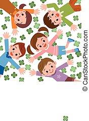 Children lying in clover