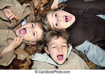 children lying on the ground