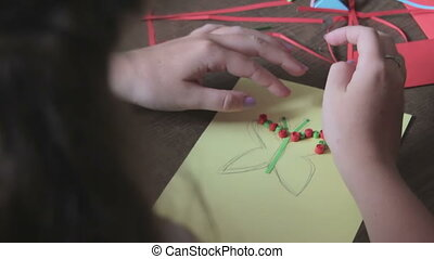 Children Make Crafts Out of Paper at the Table, HandMade....