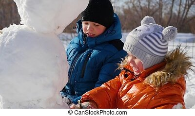 children making a snowman in the Playground