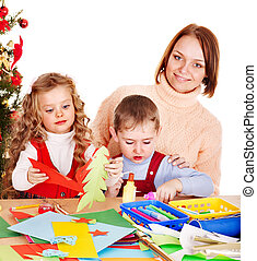 Children  making decoration for Christmas.