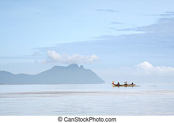 Children On A Boat - Four children on a boat at sea in Bako...