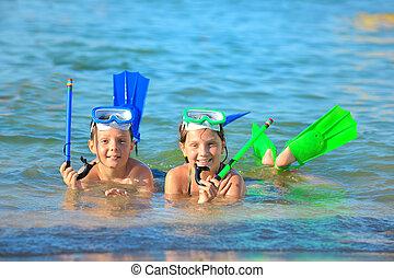 children on beach with snorkles