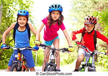 Children on bikes - Portrait of three little cyclists riding...